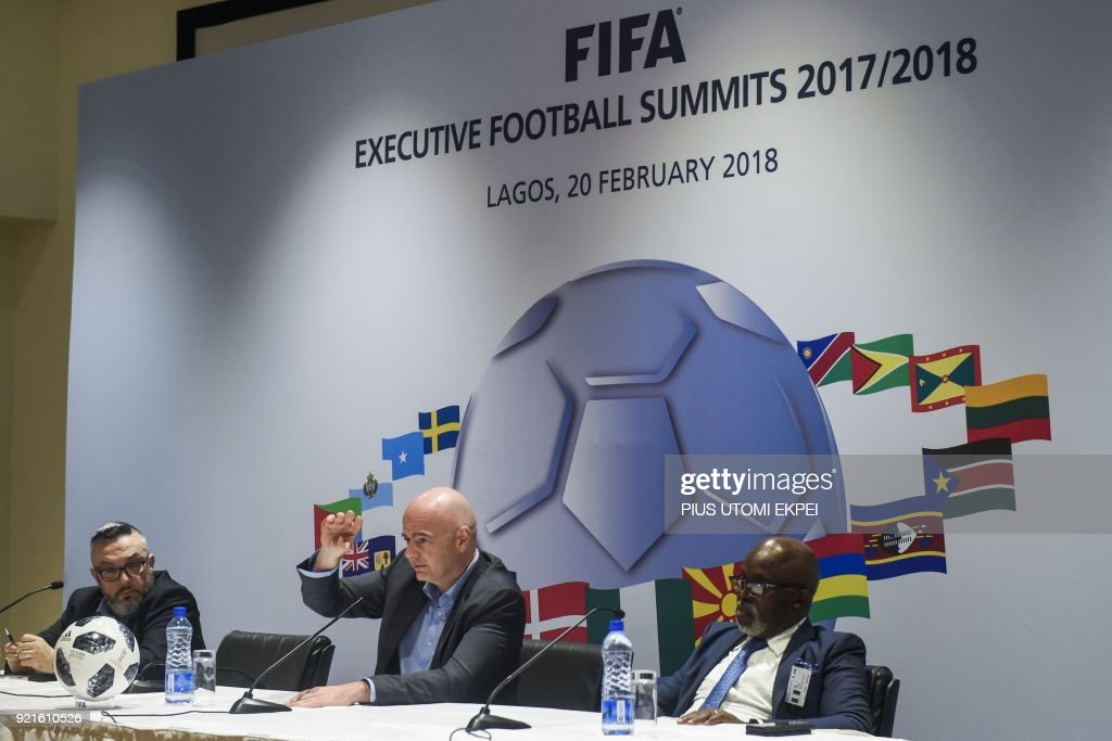 President of FIFA Gianni Infantino (C) and President of Nigeria Football Federation Amaju Pinnick (R) give a press conference at the end of the FIFA executive football summit in Lagos, on February 20, 2018. /