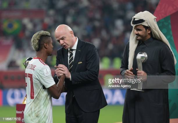 President of FIFA Gianni Infantino and Sheikh Joaan bin Hamad bin Khalifa AlThani give second trophy to player of Flamengo Bruno Henrique at the end...
