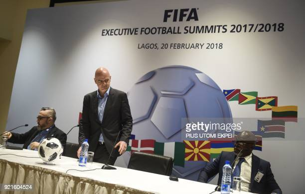 President of FIFA Gianni Infantino arrives to give a press conference at the end of the FIFA executive football summit in Lagos on February 20 2018 /...