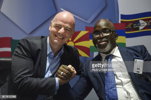 President of FIFA Gianni Infantino shakes hands with President of Nigeria Football Federation Amaju Pinnick during a press conference at the end of...