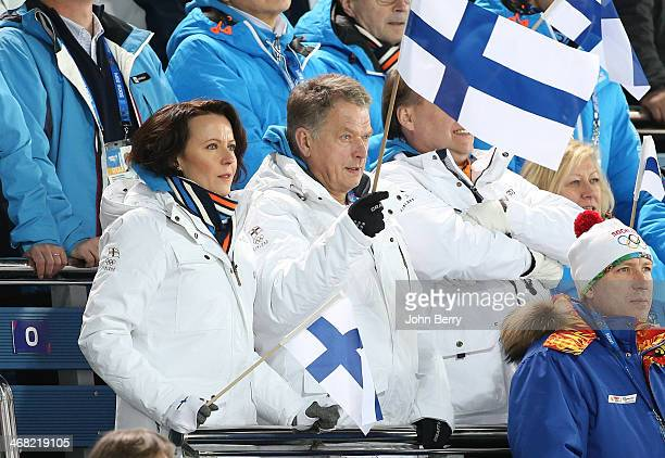 President of Finland Sauli Niinisto and his wife Jenni Haukio attend the Biathlon Women's 75 km Sprint during day two of the Sochi 2014 Winter...