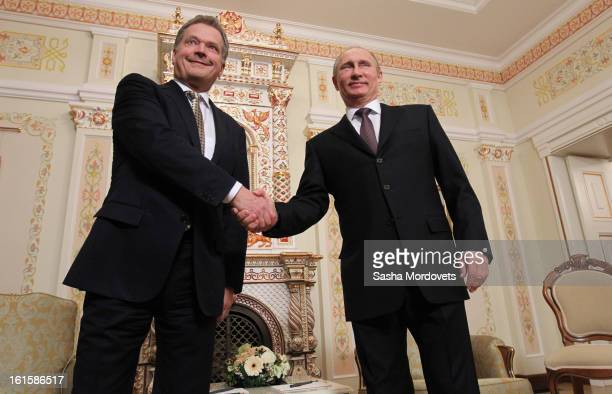 President of Finland Sauli Niinisto is welcomed by Russian President Vladimir Putin during their meeting on February 12 2013 n Moscow Russia Niinisto...