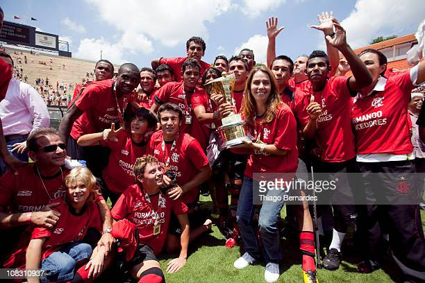 President of Flamengo Patricia Amorim raises the trophy alongside the team after the soccer match Flamengo v Bahia as part of the Sao Paulo Juniors...