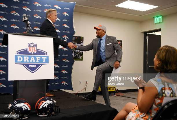 President of Football Operations/General Manager John Elway left greets their 1st round draft pick Bradley Chubb at Dove Valley April 27 2018 Chubb