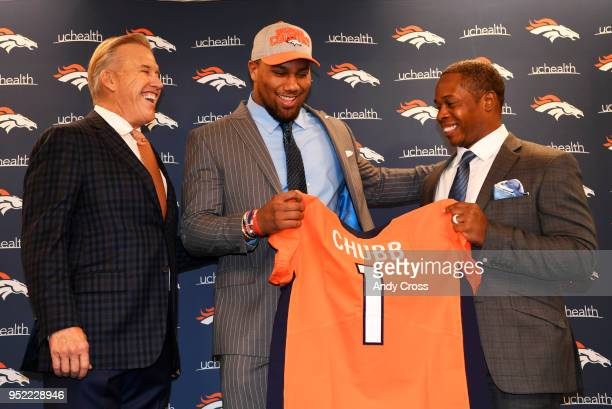 President of Football Operations/General Manager John Elway left and Denver Broncos head coach Vance Joseph right present their 1st round draft pick...