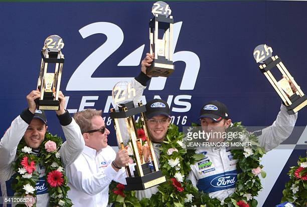 President of Ford William Clay Ford Jr and drivers Germany's Dirk Mueller France's Sebastien Bourdais and The US Joey Hand celebrate on the podium...