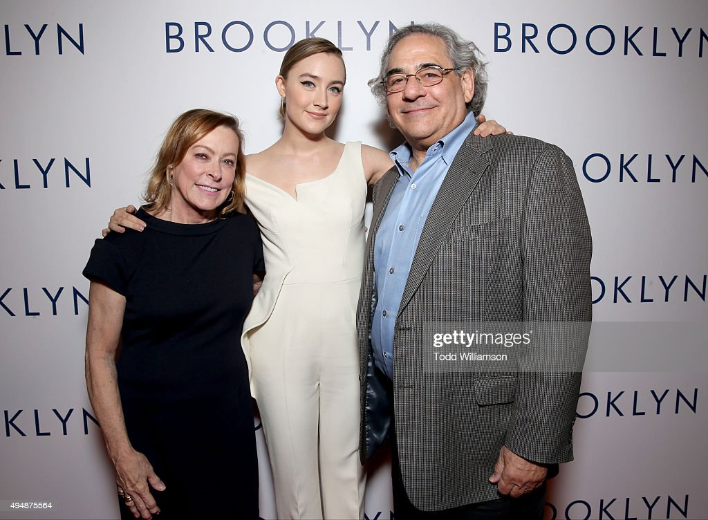 President of Fox Searchlight Nancy Utley, actress Saoirse Ronan and President of Fox Searchlight Steve Gilula arrive at the Los Angeles Premiere of Fox Searchlight's 'Brooklyn' at the Harmony Gold Theatre on October 29, 2015 in Los Angeles, California.
