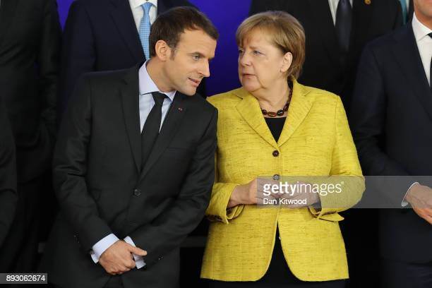 President of France Emmanuel Macron and Chancellor of Germany Angela Merkel speak during the launch of the Permanent Structured Cooperation a pact...