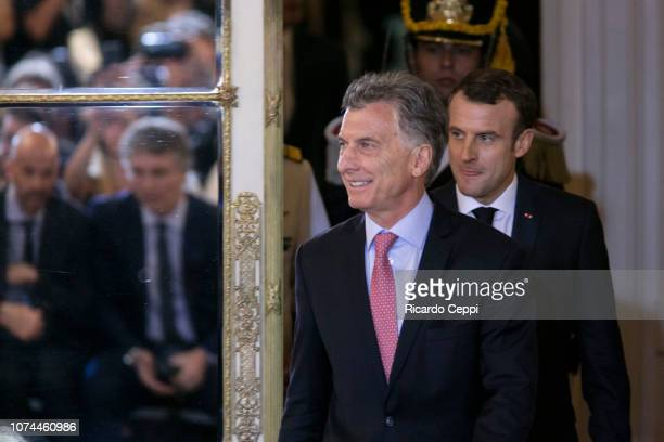 President of France Emmanuel Macron and President of Argentina Mauricio Macri step into a press conference after a meeting as part of the Argentina...
