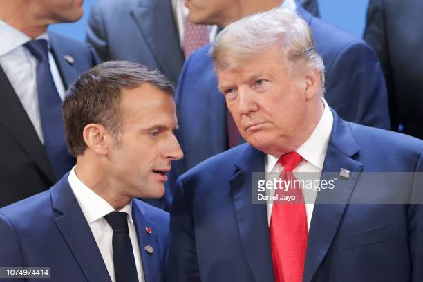President of France Emmanuel Macron and US President Donald Trump talk during the family photo on the opening day of Argentina G20 Leaders' Summit...