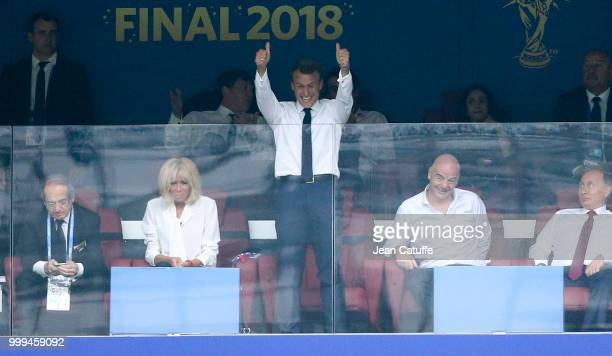 President of France Emmanuel Macron celebrates the second goal of France while his wife Brigitte Macron and FIFA President Gianni Infantino look on...