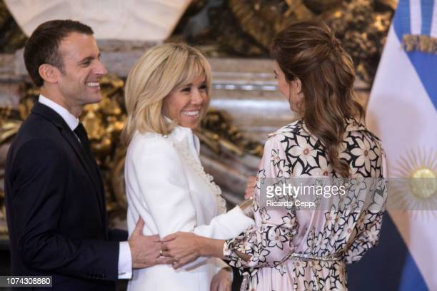 President of France Emmanuel Macron, First Lady of France Brigitte Macron and First Lady of Argentina Juliana Awada smile during a meeting between...