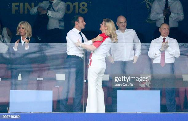 President of France Emmanuel Macron greets President of Croatia Kolinda GrabarKitarovic after the victory while his wife Brigitte Macron FIFA...