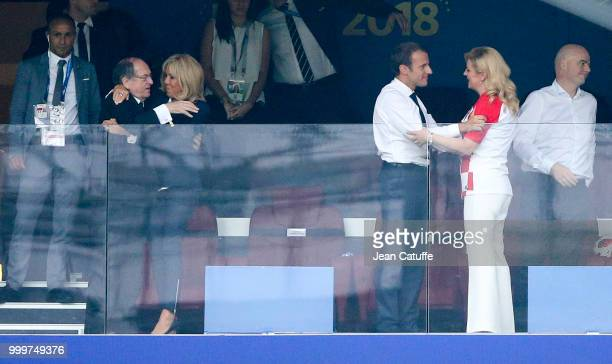 President of France Emmanuel Macron greets President of Croatia Kolinda GrabarKitarovic while his wife Brigitte Macron greets President of French...
