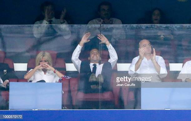 President of France Emmanuel Macron reacts to the goal of Croatia between his wife Brigitte Macron and FIFA President Gianni Infantino during the...