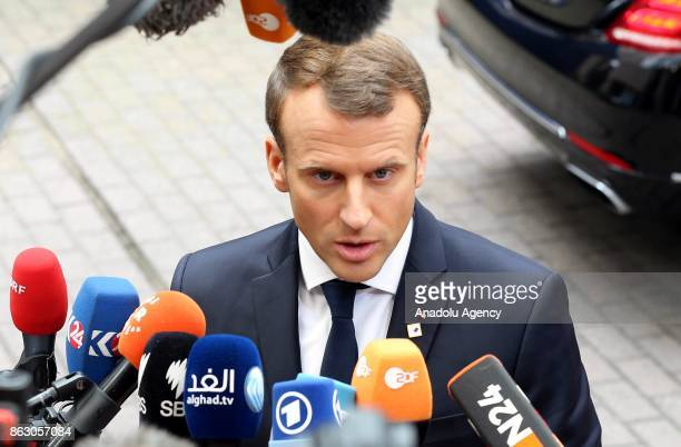 President of France Emmanuel Macron speaks to press ahead of the European Council Meeting at the Council of the European Union building on October 19...