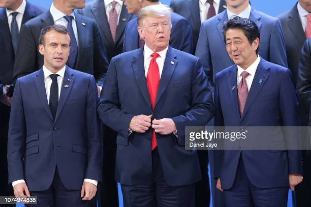President of France Emmanuel Macron US President Donald Trump and Prime Minister of Japan Shinzo Abe look on during the family photo opening day of...