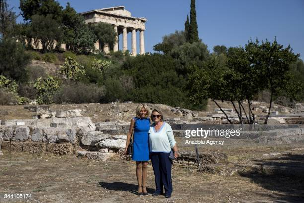 President of France Emmanuel Macron's wife Brigitte Macron and Prime Minister of Greece Alexis Tsipras' wife Vlassia PavlopoulouPeltsemi pose for a...