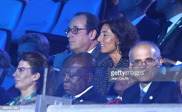 President of France Francois Hollande and his sports adviser Nathalie Iannetta attend the opening ceremony of the 2016 Summer Olympics at Maracana...