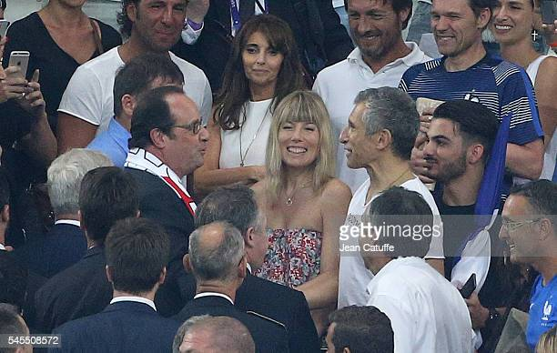 President of France Francois Hollande chats with Nagui and his wife Melanie Page above Claude Deschamps wife of Didier Deschamps following the UEFA...