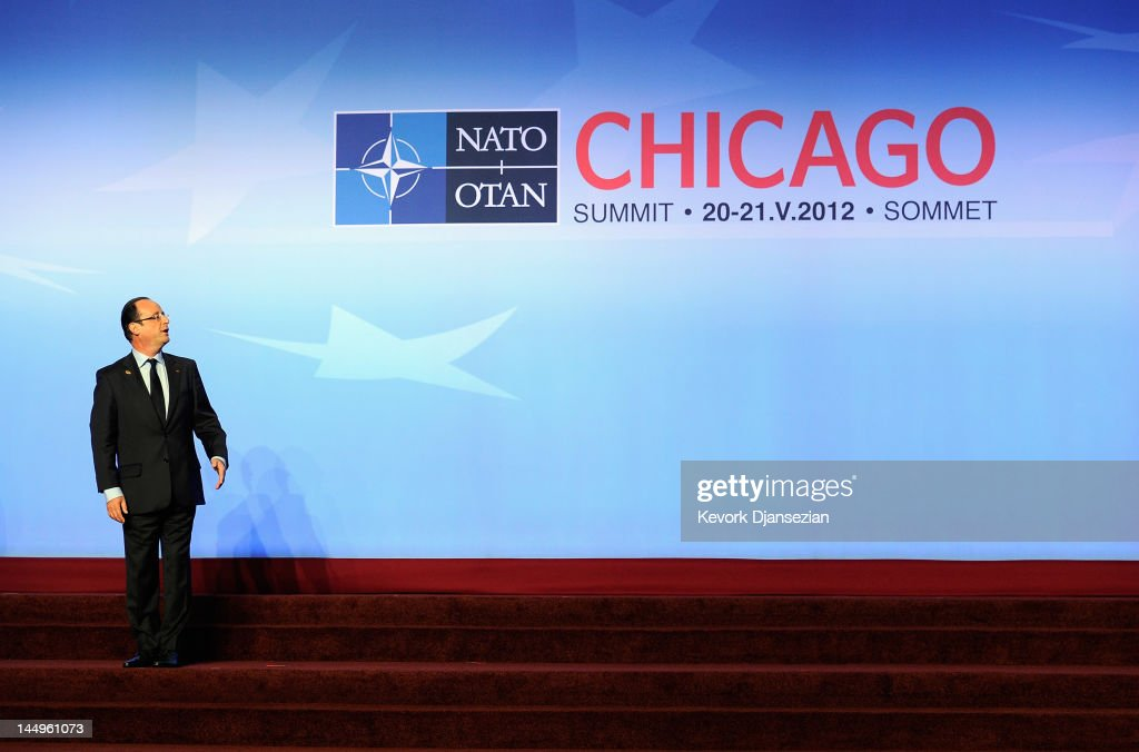 President of France Francois Hollande reacts as he departs following the family photo after meeting on Afghanistan during the NATO Summit at McCormick Place on May 21, 2012 in Chicago, Illinois. As sixty heads of state converge for the two day summit that will address the situation in Afghanistan among other global defense issues, thousands of demonstrators have taken the streets to protest.