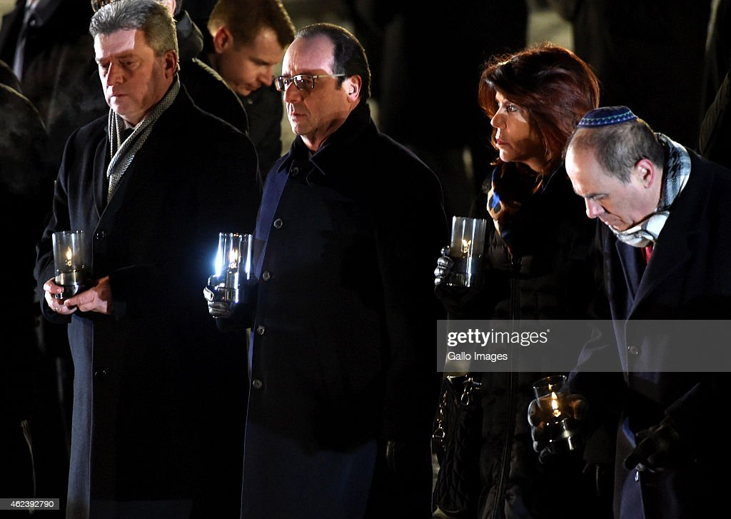 President of France Francois Hollande with a candle during the 70th anniversary of the liberation of the Nazi German concentration and extermination camp, Auschwitz-Birkenau on January 27, 2015 in Aushwitz, Poland. The day commemorates when the Soviet troops liberated the Nazi concentration camp, Auschwitz-Birkenau, in Poland on January 27, 1945. It is hoped that through remembering these events, people will remember the Holocaust and prevent further genocide from taking place.