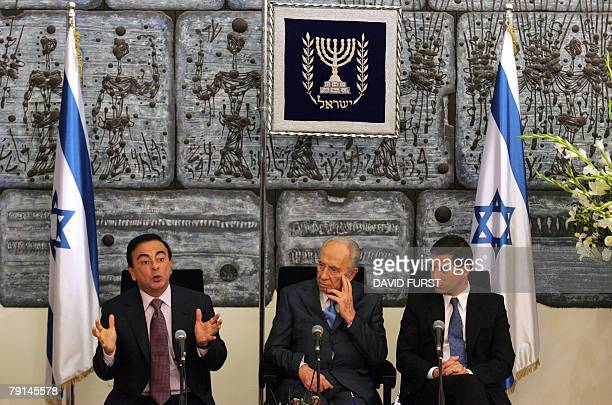 President of French automaker RenaultNissan Carlos Ghosn gestures during a joint press conference alongside Israeli President Shimon Peres and...