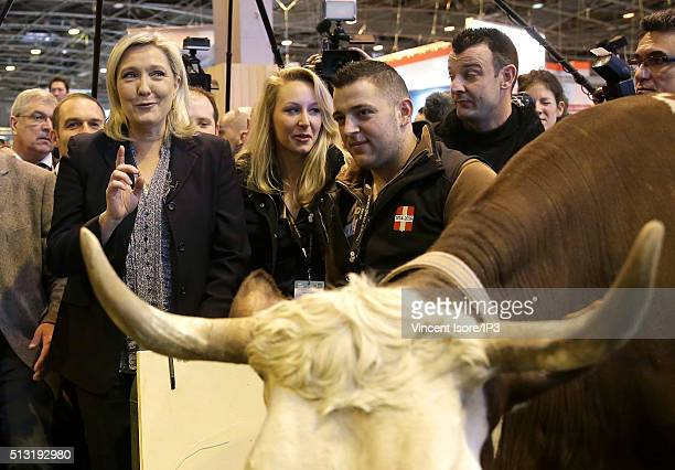 President of French far right Front National party Marine Le Pen and neice Front National MP Marion MarechalLe Pen visit the Salon de l Agriculture...