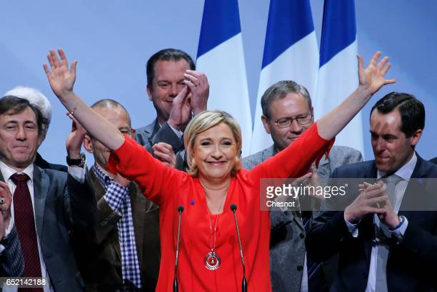 President of French farright Front National party Marine Le Pen acknowledges supporters a the end of her campaign rally on March 11 2017 in...