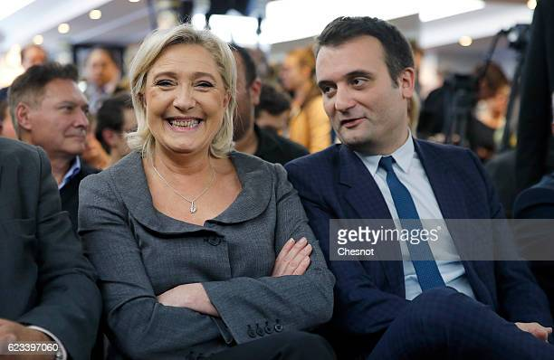 President of French farright Front National party Marine Le Pen and FN's vicepresident Florian Philippot attend a meeting on the theme ''Suburbs for...