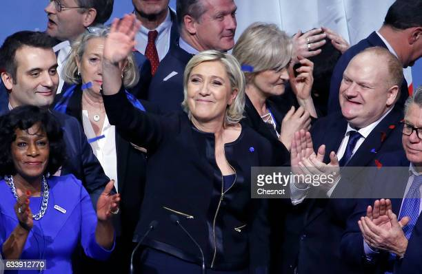 President of French farright Front National party Marine Le Pen acknowledges the public at the end of a major rally to launch her presidential...
