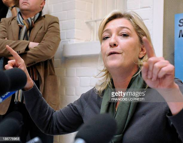 President of French far-right party Front national and candidate for the 2012 French presidential election, Marine Le Pen gives a press conference in...