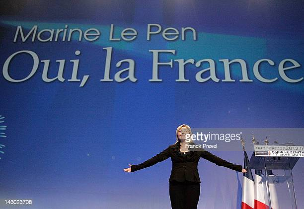 President of French farright party Front national and candidate for the 2012 French presidential election Marine Le Pen greets supporters as she...