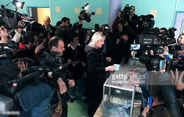 President of French farright party Front national and former candidate for the 2012 French presidential election Marine Le Pen casts her ballot at a...