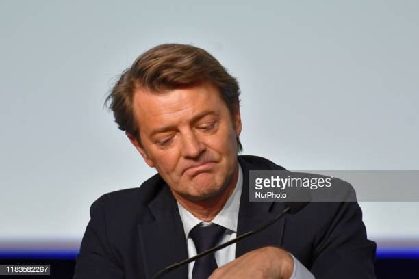 President of french Mayors Francois Baroin listens President Macron which gives speech during opening of the French Mayors Congress - November 19...