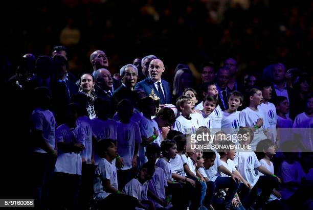 TOPSHOT President of French Rugby Federation Bernard Laporte poses with President of Japanese Rugby Federation Tadashi Okamura and children during...