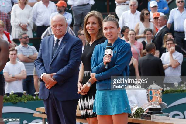President of French Tennis Federation Bernard Giudicelli Arantxa Sanchez Vicario and Winner of the Women Final Simona Halep standing on the court...