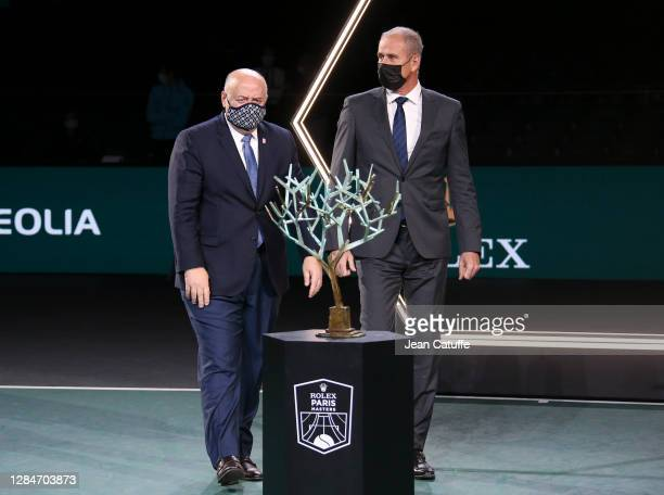 President of French Tennis Federation FFT Bernard Giudicelli, Director of the Rolex Paris Masters Guy Forget during the trophy ceremony following the...