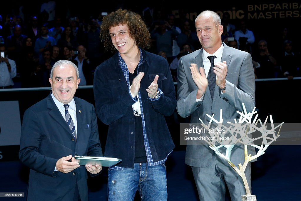 President of French Tennis Federation (FFT) Jean Gachassin, Football player David Luiz and Director of the BNP Paribas Masters Guy Forget attend the Final match during day 7 of the BNP Paribas Masters. Held at Palais Omnisports de Bercy on November 2, 2014 in Paris, France.