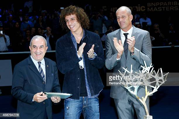President of French Tennis Federation Jean Gachassin, Football player David Luiz and Director of the BNP Paribas Masters Guy Forget attend the Final...