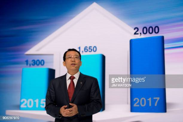 President of GAC group Feng Xingya speaks at the GAC press conference during the 2018 North American International Auto Show in Detroit Michigan on...