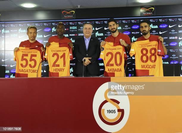 President of Galatasaray Mustafa Cengiz and Galatasaray's new transfers Henry Onyekuru Yuto Nagatomo Mugdat Celik and Emre Akbaba during their...