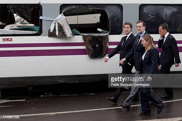 President of Galicia Alberto Nunez Feijoo, Spanish Prime Minister Mariano Rajoy and Spanish Minister of Development Ana Pastor arrive at the scene of...
