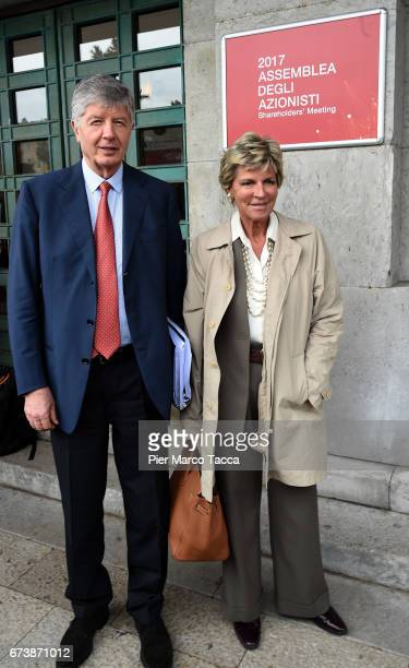 President of Generali Group Gabriele Galateri di Genola and his wife Evelina Christillin leave the Generali shareholders' meeting 2017 on April 27...