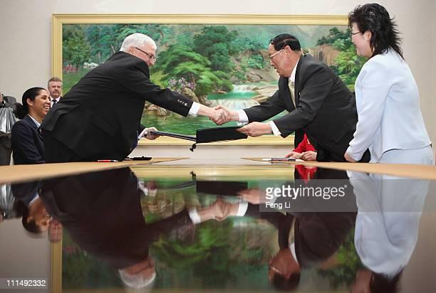 President of German Football Association Theo Twanziger and the President of DPR Korea Football Association Ri Jongmu shake hands after a signing...
