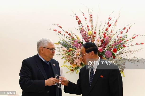 President of German Football Association Theo Twanziger attends the reception of the President of DPR Korea Football Association Ri Jongmu during the...
