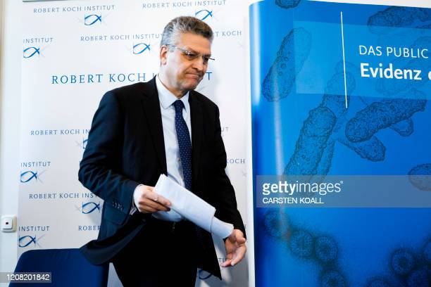 President of German Robert Koch-Institute, Lothar H. Wieler leaves after a briefing to the press on the spread of the novel coronavirus in Germany on...