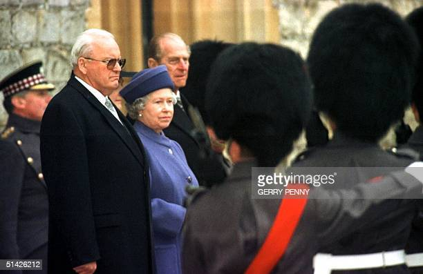 President of Germany Roman Herzog Queen Elizabeth II and the Duke of Edinburgh watch the troops march past at Windsor Castle 01 December during the...