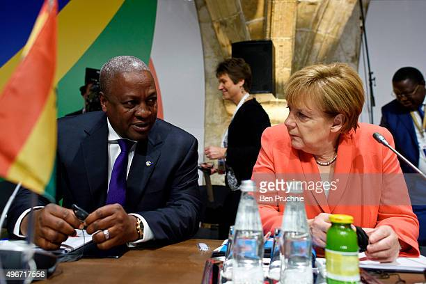 President of Ghana John Dramani Mahama and Chancellor of Germany Angela Merkel talk ahead of the first session of the Valletta Summit on migration on...