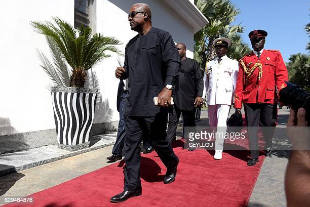 President of Ghana John Dramani Mahama arrives at a hotel in Banjul on December 13 for a meeting with regional West African leaders in a bid to...